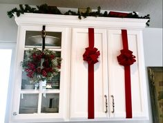 My Christmas Kitchen on todays Blog Post. @ Suitehoneydo.com Cheap ways to use ribbon to spruce up your cabinets.