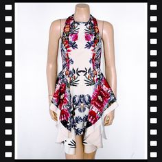 9100019ea903 Cameo the label - Short peplum style floral dress. Fully lined. Fits a size