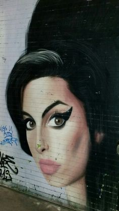 Amy Winehouse in street art at Shoreditch, London, UK