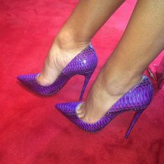 Purple pumps and toe cleavage
