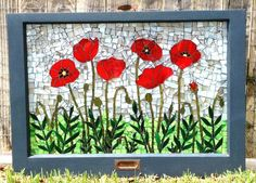 This photo is one example of a custom order of a beautiful glass-on-glass mosaic of red poppies. It is bordered by a repurposed vintage wooden