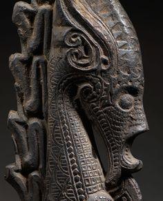 Nahalania. Heidevolk. Sea monster? Batak shaman carved horn (Naga Morsarang) stopper