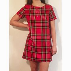 A classic red tartan shift dress with a 1960s retro feel -this is one of those perfect little dresses you can wear to brighten up any special occasion or for everyday. The shift cut and the short sleeves are very flattering and it is very comfortable to wear. Please note that this dress is available in any length you require. The classic mini version is shown here but it looks just as good in a mid thigh length or just above/on the knee. Just give me the measurement you want from should...