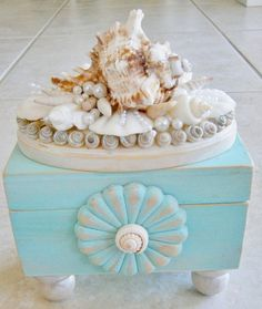 Beachy-looking seashell trinket treasure box! Painted in pretty aqua and lightly distressed, with painted silver wood accents and layers of