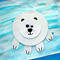 Make a paper polar bear craft with your kids this winter!