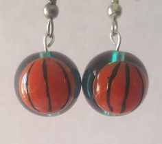 Check out this item in my Etsy shop https://www.etsy.com/listing/473086865/basketball-earrings-blue-glass-bead