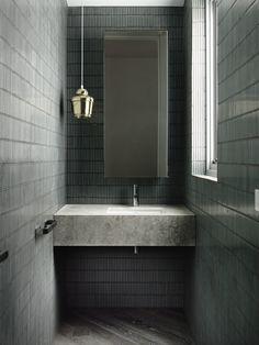 Chamberlain Javens Architects   House in Toorak. Mosaic wall tiles. Pendant. Concrete vanity.