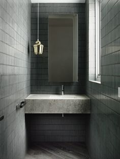 Chamberlain Javens Architects | House in Toorak. Mosaic wall tiles. Pendant. Concrete vanity.