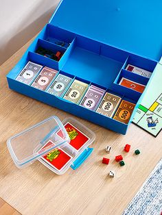 Game storage: cover corners of new games with clear packing tape inside and out for reinforcement; use clear plastic lunch containers to protect card games; if game boxes are beyond help, use Game Savers (plastic boxes designed with compartments to hold dice/game pieces/cards/spinners/boards)