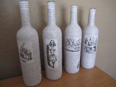 Four Alice in Wonderland Upcycled Wine Bottles. Wine and reading...two of my favourite things.