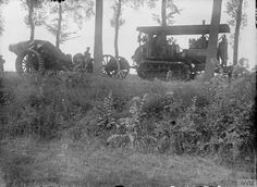 8-inch howitzer of the Royal Garrison Artillery being moved up to the forward area by half-track artillery tractor on Amiens-Albert road, September 1916.
