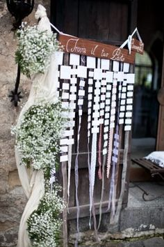 I'm not a fan of babie's breath but I could make something like this for you. with cooler flowers on the side and pictures pinned to the ribbon?