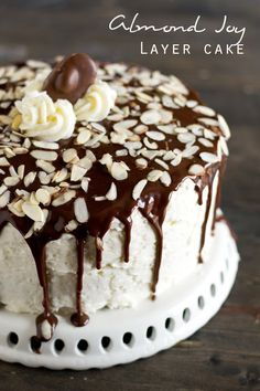 ALMOND JOY LAYER CAKE on MyRecipeMagic.com. This Almond Joy Layer Cake starts with a boxed cake mix, but has homemade coconut buttercream and a silky chocolate ganache to make it a divine dessert.