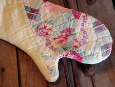 Farmhouse Oven Mitt Prim Folk Art Hand Quilted Potholder from a Charming Repurposed Patchwork Cutter Quilt. $19.99, via Etsy.