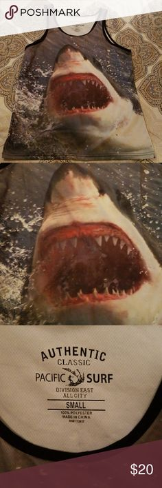 NWOT Mens Authentic Classic Pacific Surf Tank Top Shark bite tank is so cool with a great white on front and back boasting a mouth full of razor Sharif teeth. Size small but looks more like small - medium. 100% polyester. 26 inches long, top to bottom. Pacific Surf Shirts Tank Tops