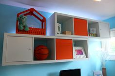 Mounting storage pieces on the wall, like these KALLAX shelving units, are a great way to organize a small space without taking up room on the floor.