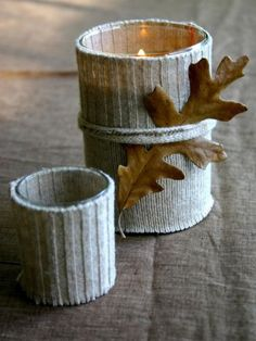 DIY Sweater Candle Holder - Old sweater cuffs are cut off and sewn to fit snugly around candle holders. Embellished with an oak leaf for fall. Old Sweater, Fall Sweaters, Knit Sweaters, Wrap Sweater, Christmas Sweaters, Harvest Decorations, Wedding Decorations, Autumn Crafts, Fall Diy