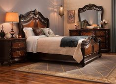 Ornate detailing defines this sumptuous Palazzo 4-piece queen bedroom set. The queen bed is richly carved and embellished with raised scrollwork, inlaid burled veneers and turned bun feet to create a stunning focal point. Equally lavish in their appointments, the dresser and nightstand also feature marble veneer tops as the perfect finishing touch.