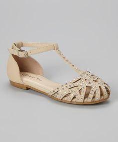Little feet won't fuss stepping out in these sweet sandals. An adjustable buckle strap seals this posh pair around ankles, while rhinestone details and a cutout design craft an elegantly artsy appeal that works with all sorts of ensembles.