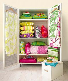 Great use of an armoire...love all of the colors!