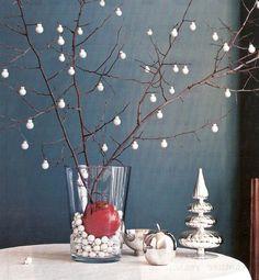 tiny christmas bulbs on branches