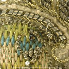 Detail of parrot motif. Magnification 10x. Image by Cristina Balloffet Carr. ca.1600,British. Leather,satin worked with silk and metal thread,seed pearls;satin,couching, and darning stitches;metal bobbin lace;paper. L.12 1/4 x W.6 1/4 inches (31.1 x 15.9 cm) Credit Line:Gift of Mrs. Edward S. Harkness, 1928 (28.220.7, .8)
