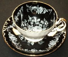 Aynsley England White Rose & Black Footed Tea Cup and Saucer ca. 1939...love this set...I want one.