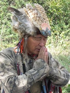 """Oorzhak Nikolay Munzukovich, the Tuvan shaman, the 13th shaman calling 12 Great shamans of the world, director of the Company """"Suldelig"""", author of shamanic system for spiritual development and improving the health, based on throat singing """"Un-Hun"""" (""""Sound of the Sun""""), a hereditary shaman, khoomeiji (master of throat singing), musician, healer, corresponding member of the Russian Association of Traditional Medicine -13 Shamans."""