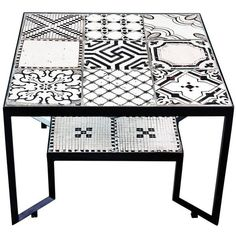 Stylish Black 'spider' Tiles Table ($5,200) ❤ liked on Polyvore featuring home, furniture, tables, accent tables, black, coffee tables, black accent table, iron accent table, outdoor table and outside coffee table