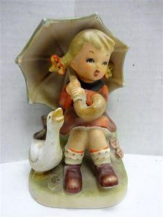 Arnart Girl w Umbrella & Goose Erich Stauffer - shopgoodwill.com