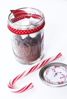 Oh goodness this one is even cuter =) Favors - hot chocolate mix in mason jars!