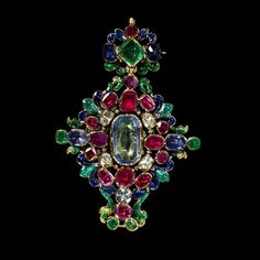 Enamelled gold openwork lozenge pendant set with sapphires, rubies, emeralds and rose-cut diamonds, the back with a bowl of fruit in painted enamel. Europe, late 17th century