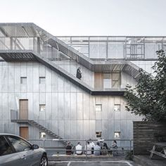 Swathes of semi-translucent glass and an external staircase were used to enhance this building's transparency.