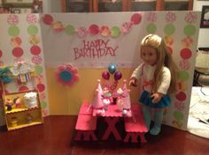 American Girl Birthday Room.  Made from a three fold science project board.  The picnic table is made from larger popsicle sticks and wooden letters for the supports.  The decorations were done with the cricut and and srapbook paper. The sweet stand was made from a box covered in foam board. Homemade party hats and cotton candy.