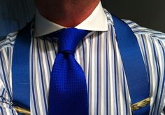 Blue braces, blue necktie and blue and white striped shirt with a spread collar!