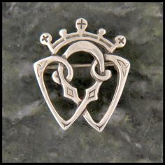 Sweet and dainty Luckenbooth brooch designed by Walker Metalsmiths, inspired by Scottish Heritage.