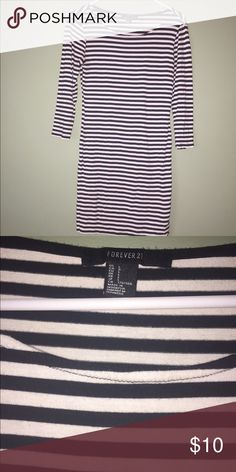 B&W Striped Tunic Dress Black and white stripes. 3/4 sleeves. Can be worn with tights or leggings or on its own depending on how you prefer. Cute with a belt and boots as well. Great condition. Forever 21 Dresses Mini