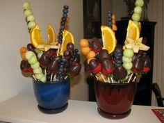 Create your own edible arrangements. skewers, cut fruit, container, & floral foam to stick skewers in.