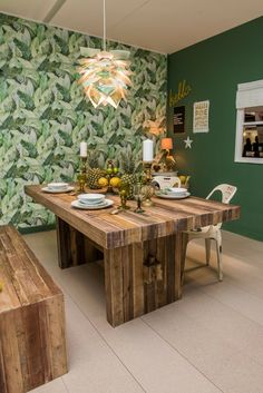 Ever fancied e design, we offer an affordable interior design service for a single room or a full house renovation, all with a focus on using upcycled materials wherever stylishly possible to source and creating your perfect modern rustic home. Like this tropical rustic dining room with reclaimed wood dining furniture, botanical palm leaf wallpaper and dark green walls...we added a touch of glam with gold accessories in keeping with the tropical vibe.