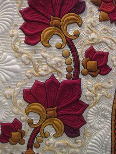 splendiferoushoney:  Detail of Crimson Promises made by Sharon Schamber - winner of the Master Award for innovative artistry at The Houston International Quilt Show 2011 photo by Fran