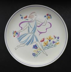 This is a completely delighted mid century Poole display plate or charger…