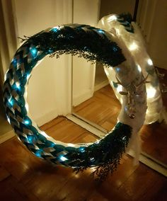 """The """"Blue Ice"""" wreath by Sabrina B. 22"""" w/warm white lights. $85. www.lovemywreathshop.com or email: www.lovemywreath@yahoo.com"""