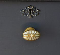 Cool! Refinished dresser dark grey with antique brass and mother of pearl knobs by thedabble, via Flickr