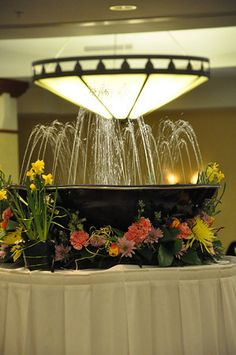 Daffodils, Tulips,Spider Mums, Daisies, and Hyacinth encircle a relaxing fountain.  Flowers by Victoria Floral Designs