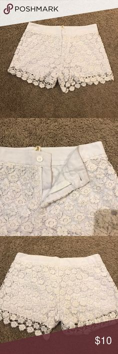 Lace white shorts Cotton lace white shorts with a polyester lining. Size small. Worn a few times Sans Souci Shorts Skorts