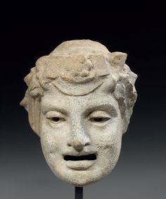 Comedy mask of a youth from the Dyonisos cortege.  Terracotta.  Hellenistic…