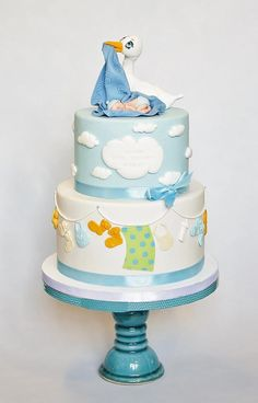 Okay, if you stumbled upon on this article I am sure you need a baby shower idea, so start looking at these wonderful baby shower cake designs for Amazing Baby Shower Cakes, Baby Shower Cakes For Boys, Torta Baby Shower, Beautiful Cakes, Amazing Cakes, Stork Cake, Baby Shower Cake Designs, Rodjendanske Torte, Stork Baby Showers