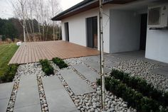 river pebbles   contemporary pavers   decking    entrance driveway