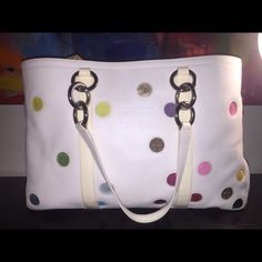 Coach large purse Very rare limited addition Coach purse. Was a special order that only was available at Flagship stores. White leather with white patten leather trim detail. Polka dot cut out with bright suede and logo material. Gently used and slight wear on bottom as any normal white bag would have. Clean and stain free inside. Dust bag included. Coach Bags