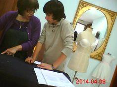 Teaching  how  to  cut  a  dress